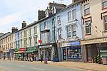 Row of shops in town centre of Porthmadog, Gwynedd, north west Wales, UK