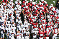5 April 2008: Head coach Jim Harbaugh talks to the football team during practice at Stanford Stadium in Stanford, CA.