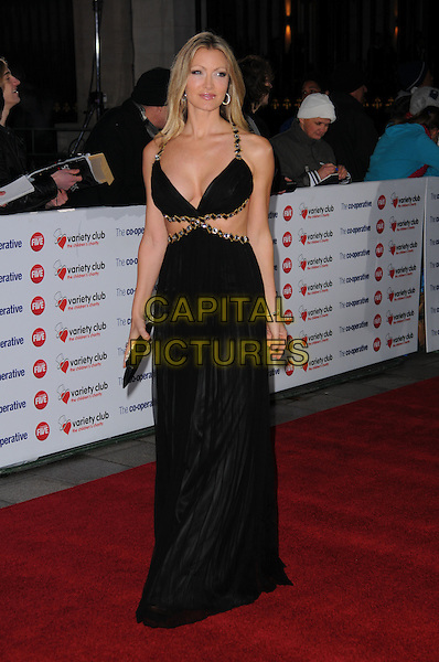 CAPRICE BOURRET .The Co-operative Variety Club Showbiz Awards, Grosvenor House Hotel, Park Lane, London, England, UK, .14th November 2010. .full length black cleavage straps gold cut out away side dress jewelled beaded long maxi clutch bag .CAP/CAS.©Bob Cass/Capital Pictures.