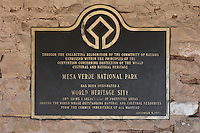 Plaque outside the Mesa Verde Museum designating the park a UNESCO World Heritage Site, September 8th 1978, in Mesa Verde National Park, Montezuma County, Colorado, USA. Mesa Verde is the largest archaeological site in America, with Native Americans inhabiting the area from 7500 BC to 13th century AD. Picture by Manuel Cohen