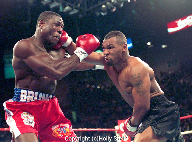 Mike Tyson delivers a right to Frank Bruno during their heavyweight championship fight.  Tyson W TKO3.  WBC Heavyweight title.
