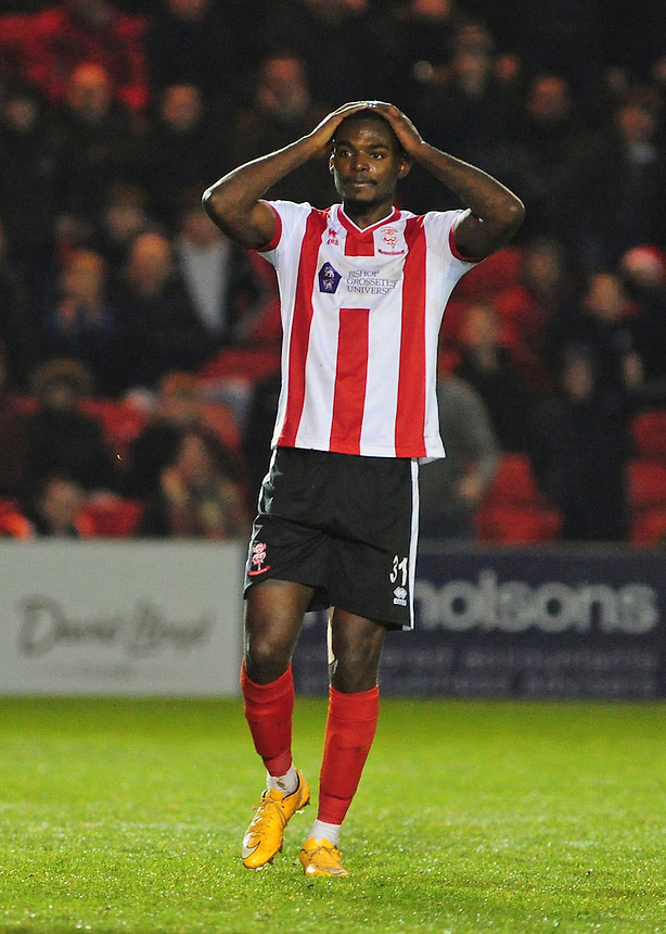 Lincoln City&rsquo;s Theo Robinson reacts after missing a good opportunity<br /> <br /> Photographer Andrew Vaughan/CameraSport<br /> <br /> Vanarama National League - Lincoln City v Tranmere Rovers - Saturday 17th December 2016 - Sincil Bank - Lincoln<br /> <br /> World Copyright &copy; 2016 CameraSport. All rights reserved. 43 Linden Ave. Countesthorpe. Leicester. England. LE8 5PG - Tel: +44 (0) 116 277 4147 - admin@camerasport.com - www.camerasport.com
