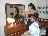 Feb 12 2003, Holguin, CUBA <br /> A Teenager help her mother  getting ready for her Cuban civil wedding in Holguin,<br /> Photo (c) 2004) P Roussel / Images Distribution