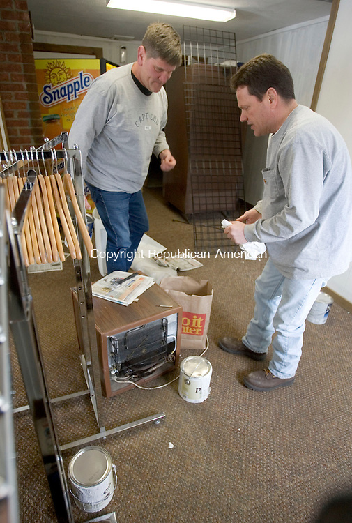 NAUGATUCK, CT. 25 February 2013-022613SV04-From left, Chris Jones and Mike Caron, from the Town of Naugatuck, work on renovations in the pro shop at Hop Brook Golf Course in Naugatuck Tuesday..Steven Valenti Republican-American
