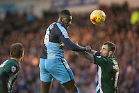 Aaron Pierre of Wycombe Wanderers beats Peter Hartley of Plymouth Argyle in the air to head at goal during the Sky Bet League 2 match between Plymouth Argyle and Wycombe Wanderers at Home Park, Plymouth, England on 30 January 2016. Photo by Mark  Hawkins / PRiME Media Images.