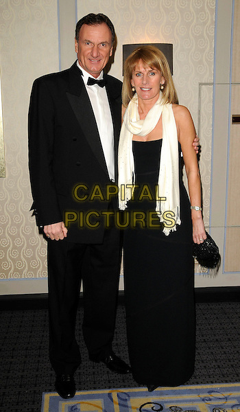 PHIL THOMPSON & GUEST.AT The Marriott Burns Night Ball, The Marriott Hotel, Grosvenor Square, London, England, January 23rd 2009..full length black suit tuxedo tux white cream scarf dress bow tie .CAP/CAN.©Can Nguyen/Capital Pictures