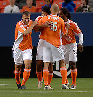 Brian Ching (second from left) celebrates his 16th minute goal with teammates Eddie Robinson, Craig Waibel and Adrian Serioux. The Houston Dynamo beat the Colorado Rapids 1-0 on a goal by Brian Ching, April 29, 2006, at Invesco Field at Mile High Stadium in Denver, Colorado.