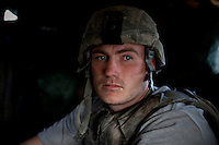 US Army Soldier Private First Class Young from Viper Company 126, 1st Platoon, at Restrepo Firebase in the restive Korengal Valley. Restrepo, a remote outpost, is known as one of the most violent places in Afghanistan. Located in the Korengal Valley it comes under fire on a daily basis from Anti-Afghan Forces in the local villages and mountains.