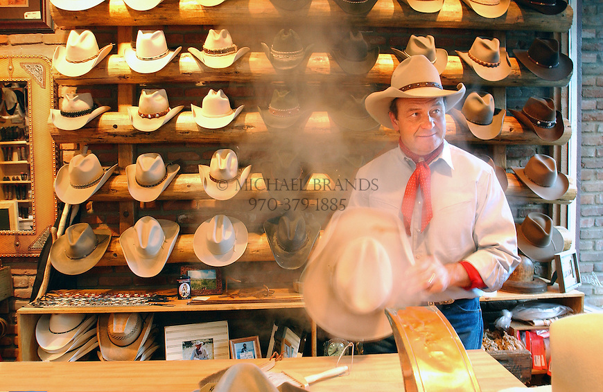 Kemosabe owner Tom Yoder steam shapes a cowboy hat by hand in Aspen, Colorado. © Michael Brands. 970-379-1885.