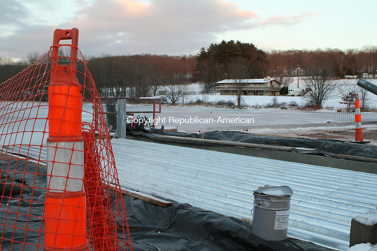 WATERTOWN, CT-12 December 2013-121213LW01 - Workers are replacing the bridge at the entrance to Crestbrook Park on Northfield Road this week with a preengineered galvanized steel bridge with an asphalt deck.<br /> The new bridge replaces the one that was damaged in January 2012 when a hole opened in its deck as a town truck drove over it.<br /> Construction on the bridge began Dec. 8 and should be finished by sunset today.<br /> Laraine Weschler Republican-American