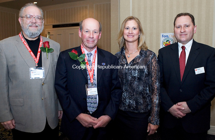 SOUTHBURY, CT- 04 MAY 2008- 050408JT23-<br /> From left, EMS Award recipient Chet Sergey with Humanitarian Award recipient Ed Abrams and wife Lorrie, and Red Cross board member Antonio Pinto during the American Red Cross' &quot;Images of Heroes&quot; gala on Saturday, May 3 at the Crowne Plaza in Southbury. Other award recipients were Jesse Giguere with Global Impact, Kendrik Lechner with Good Samaritan (youth), Meghan Edwards with Good Samaritan (adult), and Laura Coffin with Community Impact.<br /> Josalee Thrift / Republican-American