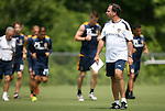 28 May 2012: Head coach Bruce Arena (right) watches his team jog around the field during warmups. The Los Angeles Galaxy held a training session on Field 6 at WakeMed Soccer Park in Cary, NC the day before playing in a 2012 Lamar Hunt U.S. Open Cup third round game.
