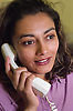 Young woman talking on telephone,