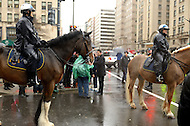 December 7, 2011  (Washington, DC) Mounted officers of the DC Metropolitan Police Department stand by as OccupyDC protesters block a busy downtown DC street..   (Photo by Don Baxter/Media Images International)