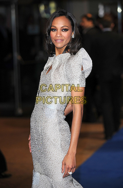 "ZOE SALDANA .Attending the World Premiere of ""Avatar"", Odeon Leicester Square, London, England, UK, .10th December 2009..half length dress long maxi grey gray silver shoulder pads side necklace smiling .CAP/BEL.©Tom Belcher/Capital Pictures."