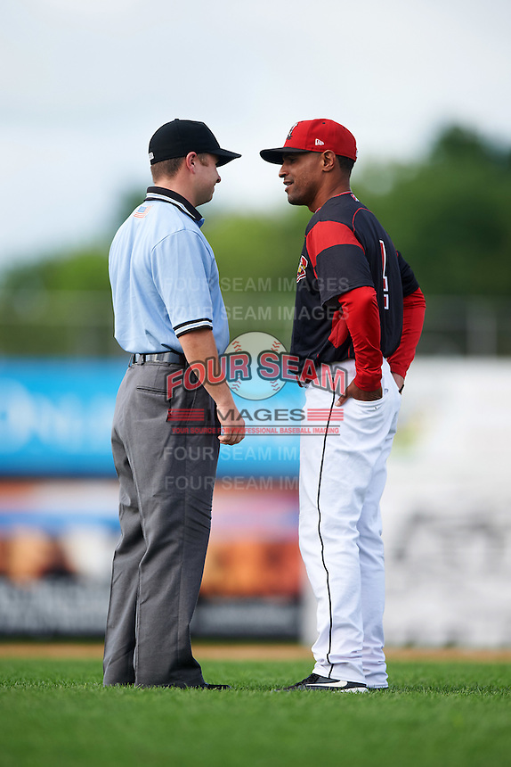Batavia Muckdogs manager Angel Espada (4) discusses a call with umpire John Budka during a game against the Hudson Valley Renegades on July 31, 2016 at Dwyer Stadium in Batavia, New York.  Hudson Valley defeated Batavia 4-1. (Mike Janes/Four Seam Images)