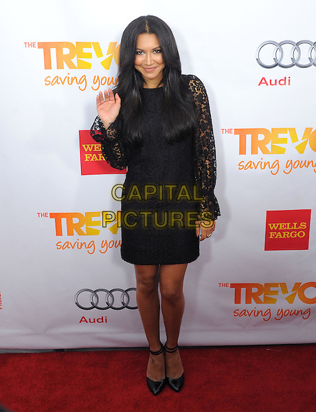 "Naya Rivera.The Trevor Project's ""Trevor Live"" 2012 held at the Hollywood Palladium, Hollywood, California, USA..December 2nd, 2012.full length dress hand arm waving lace black .CAP/RKE/DVS.©DVS/RockinExposures/Capital Pictures."