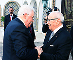 Tunisian President Beji Caid Essebsi shakes hands with Palestinian President Mahmoud Abbas during a welcome ceremony at Carthage Palace, near Tunis, on July 6, 2017. Abbas is on 2 day official visit to Tunisia. Photo by Thaer Ganaim