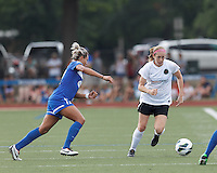 Portland Thorns FC defender Nikki Marshall (7) brings the ball forward.  In a National Women's Soccer League (NWSL) match, Portland Thorns FC (white/black) defeated Boston Breakers (blue), 2-1, at Dilboy Stadium on July 21, 2013.