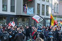 """Ca. 1000 Neonazis, Skinheads und Hooligans demonstrierten am Tag der Deutschen Einheit in Berlin unter dem Motto """"Wir fuer Deutschand - Merkel muss weg"""" in Berlin.<br /> Im Bild: Anwohner an der Aufmarschroute haben ein Transparent gegen die Nazis am Balkon aufgehaengt.<br /> 3.10.2018, Berlin<br /> Copyright: Christian-Ditsch.de<br /> [Inhaltsveraendernde Manipulation des Fotos nur nach ausdruecklicher Genehmigung des Fotografen. Vereinbarungen ueber Abtretung von Persoenlichkeitsrechten/Model Release der abgebildeten Person/Personen liegen nicht vor. NO MODEL RELEASE! Nur fuer Redaktionelle Zwecke. Don't publish without copyright Christian-Ditsch.de, Veroeffentlichung nur mit Fotografennennung, sowie gegen Honorar, MwSt. und Beleg. Konto: I N G - D i B a, IBAN DE58500105175400192269, BIC INGDDEFFXXX, Kontakt: post@christian-ditsch.de<br /> Bei der Bearbeitung der Dateiinformationen darf die Urheberkennzeichnung in den EXIF- und  IPTC-Daten nicht entfernt werden, diese sind in digitalen Medien nach §95c UrhG rechtlich geschuetzt. Der Urhebervermerk wird gemaess §13 UrhG verlangt.]"""