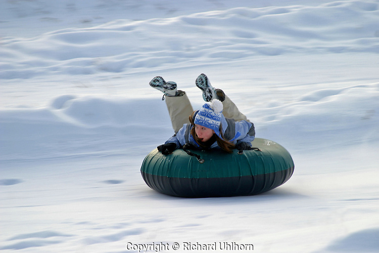 Sledding hills are becoming popular alternatives at ski resorts for those who don't ski. This young lady is having fun at the Echo Valley Ski Area in Lake Chelan, Washington