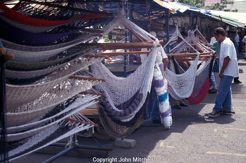 Tourists shopping for hammocks in a handicraft market, San Jose, Costa Rica