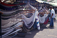 Tourists shopping for hammocks in a handicraft market, San Jose, Costa Rica