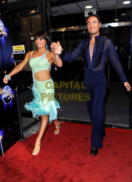 FLAVIA CACACE & VINCENT SIMONE.'Strictly Come Dancing' Launch Event at BBC Studios, London, England..September 7th 2011.full length blue dress feathers cut out sides blue trousers sheer shirt holding hands walking .CAP/FIN.©Steve Finn/Capital Pictures.