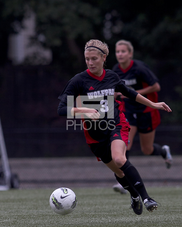 NC State forward Meagan Proper (3) brings the ball out. Boston College defeated North Carolina State,1-0, on Newton Campus Field, on October 23, 2011.
