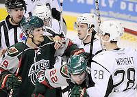 San Antonio Rampage and Houston Aeros players scrum during the third period of an AHL hockey game, Sunday, Oct. 14, 2012, in San Antonio. San Antonio won 3-2. (Darren Abate/pressphotointl.com)