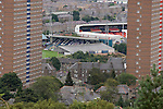 A view from the top of Dundee Law showing the city's two senior football grounds, with Dundee FC's Dens Park visible in the foreground and Dundee United's Tannadice Park in the background. The two stadia were situated on the same street, a few hundred yards apart.