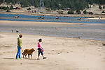 mother and daughter walking golden retriever at the lake, Estes Park, Colorado, USA, model releases # 96, 126