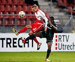 Nederland, Utrecht, 26 oktober 2012.Eredivisie.Seizoen 2012-2013.FC Utrecht-FC Groningen.Mike van der Hoorn (l.) van FC Utrecht en Genero Zeefuik (r.) van FC Groningen strijden om de bal.