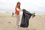Pacific Elementary School Student On Beach Cleanup