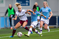 17th November 2019; Academy Stadium, Manchester, Lancashire, England; The FA Womens Super League, Manchester City Women versus West Ham United Women; Alisha Lehmann of West Ham Women is tackled by Demi Stokes of Manchester City Women - Editorial Use