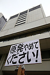A Protester holds banner during an anti-nuclear rally in front of the headquarters of Tokyo Electric Power Co (TEPCO), the operator of the tsunami-crippled Fukushima Daiichi nuclear plant, on the fifth anniversary of the Great East Japan Earthquake and Tsunami disaster in Tokyo, Japan on March 11, 2016. Almost 19,000 people lost their lives as a result of the magnitude 9.0 earthquake and subsequent tsunami that hit Japan's north east coast 5 years ago. Five years after the event some 174,000 survivors are still in temporary accommodation. This includes nearly 100,000 from Fukushima who have not been able to return home as a result of the effects of the tsunami and nuclear catastrophe that ensued. (Photo by Shingo Ito/AFLO)