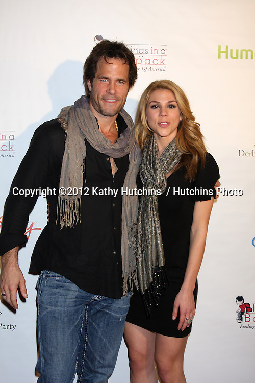 LOS ANGELES - JAN 12:  Shawn Christian, Kate Mansi.. arrives at  the Los Angeles Derby Prelude Party at The London Hollywood Hotel on January 12, 2012 in West Hollywood, CA