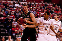 30 November 2011: Carson Desrosiers #33 of the Wake Forest Demon Deacons gets the rebound from Toney McCray #0 of the Nebraska Cornhuskers at the Devaney Sports Center in Lincoln, Nebraska. Wake Forest defeated Nebraska 55 to 53.