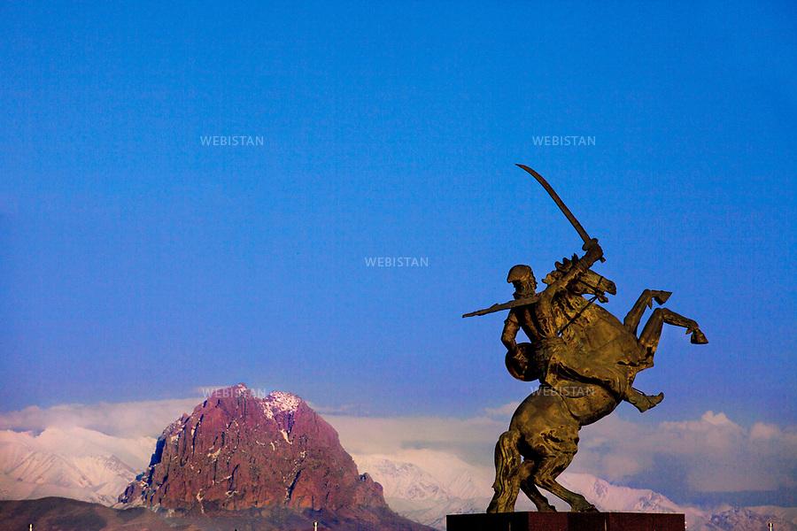 Azerbaijan, Nakhchivan, Koroglu Statue, April 3, 2012<br /> The Epic of Koroglu is a heroic legend popular among the Turkic peoples that is believed to date from the 11th century AD. Koroglu is a hero of the people who fights against unjust rulers. A statue of Koroglu on a rearing horse stands tall next to the fabled Ilandagh Mountain. <br /> <br /> Azerba&iuml;djan, Nakhtchyvan, statue de Koroglu, 3 avril 2012 <br /> L&rsquo;&eacute;pop&eacute;e de Koroglu est une l&eacute;gende h&eacute;ro&iuml;que populaire racont&eacute;e chez les peuples turcs, que l&rsquo;on date du XIe si&egrave;cle. Koroglu est un h&eacute;ros du peuple se battant contre des injustices. Une statue de Koroglu sur un cheval cabr&eacute; se dresse fi&egrave;rement &agrave; c&ocirc;t&eacute; de la fameuse montagne Ilandagh (&laquo; la montagne du Serpent &raquo;).