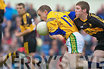 Brian Scanlon (Feale Rangers) shields the ball from David O'Leary (Dr Crokes) in their County Championship Semi-final at Austin Stack park on Sunday.