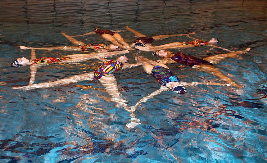 Aqualina Stevenage synchronised swimmers perform for Sport Relief <br /> <br /> Photo by Kieran Galvin/CameraSport<br /> <br /> Sport Relief publicity shoot  - Aqualina Stevenage synchronised swimmers - Friday 7th March 2014 - Stevenage Swimming Centre - Stevenage<br /> <br /> &copy; CameraSport - 43 Linden Ave. Countesthorpe. Leicester. England. LE8 5PG - Tel: +44 (0) 116 277 4147 - admin@camerasport.com - www.camerasport.com