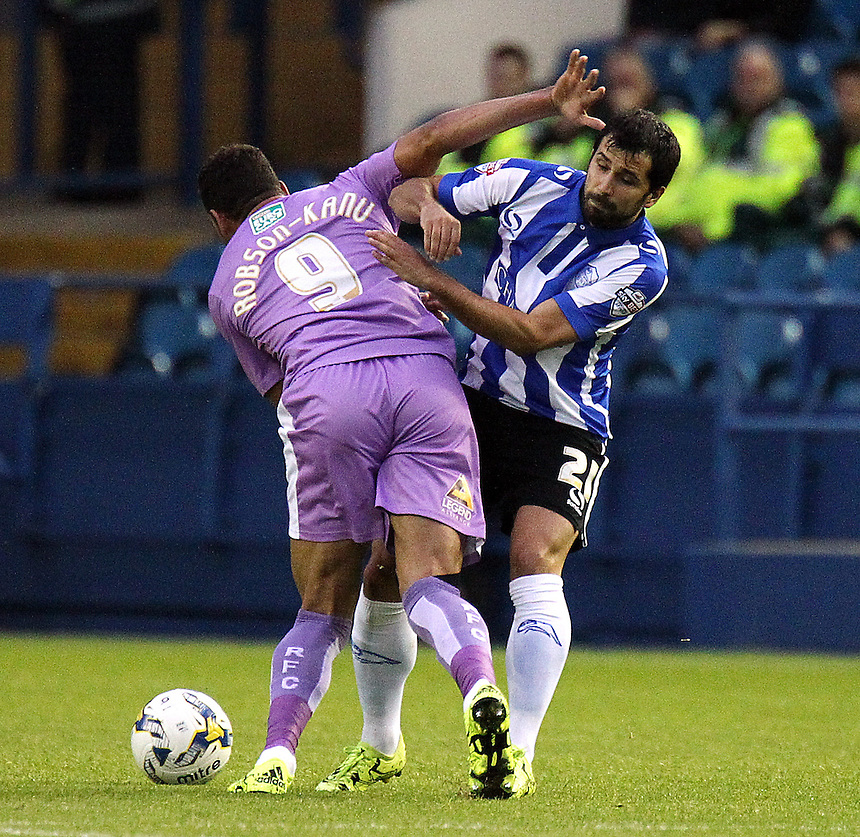 Reading's Hal Robson-Kanu (left) battles with Sheffield Wednesday's Alex Lopez<br /> <br /> Photographer Rich Linley/CameraSport<br /> <br /> Football - The Football League Sky Bet Championship - Sheffield Wednesday v Reading - Wednesday 19th August 2015 - Hillsborough - Sheffield<br /> <br /> &copy; CameraSport - 43 Linden Ave. Countesthorpe. Leicester. England. LE8 5PG - Tel: +44 (0) 116 277 4147 - admin@camerasport.com - www.camerasport.com