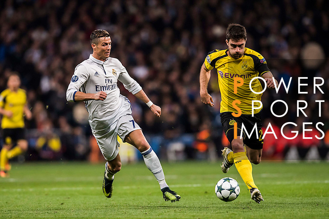 Cristiano Ronaldo of Real Madrid battles for the ball with Sokratis Papastathopoulos of Borussia Dortmund during the 2016-17 UEFA Champions League match between Real Madrid and Borussia Dortmund at the Santiago Bernabeu Stadium on 07 December 2016 in Madrid, Spain. Photo by Diego Gonzalez Souto / Power Sport Images