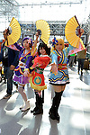 Manhattan, New York City, New York, USA. October 10, 2015. At extreme right, Ginko from NYC portrays character Eli Ayase, a main character in Love Live!, along with two other cosplayers at the 10th Annual New York Comic Con. NYCC 2015 is expected to be the biggest one ever, with over 160,000 attending during the 4 day ReedPOP event, from October 8 through Oct 11, at Javits Center in Manhattan
