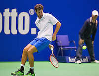 December 20, 2014, Rotterdam, Topsport Centrum, Lotto NK Tennis, Robin Haase (NED) hits the ball behind his back<br /> Photo: Tennisimages/Henk Koster