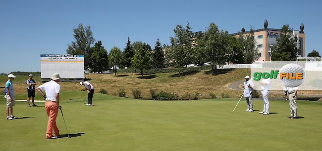 Watched by amateurs Alex Noren (SWE) putts on the 18th during the preview days of the 2015 Alstom Open de France, played at Le Golf National, Saint-Quentin-En-Yvelines, Paris, France. /30/06/2015/. Picture: Golffile | David Lloyd<br /> <br /> All photos usage must carry mandatory copyright credit (&copy; Golffile | David Lloyd)