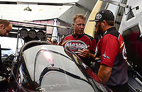 Sept. 16, 2012; Concord, NC, USA: NHRA top fuel dragster driver Shawn Langdon (right) with crew chief Brian Husen during the O'Reilly Auto Parts Nationals at zMax Dragway. Mandatory Credit: Mark J. Rebilas-