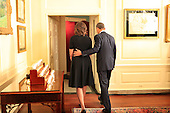 United States President Barack Obama and first lady Michelle Obama depart the Map Room of the White House after participating in a candle lighting ceremony to remember the 20 children and 6 adult school employees killed at the Sandy Hook Elementary School in New Town, Connecticut one year ago today.  <br /> Credit: Dennis Brack / Pool via CNP