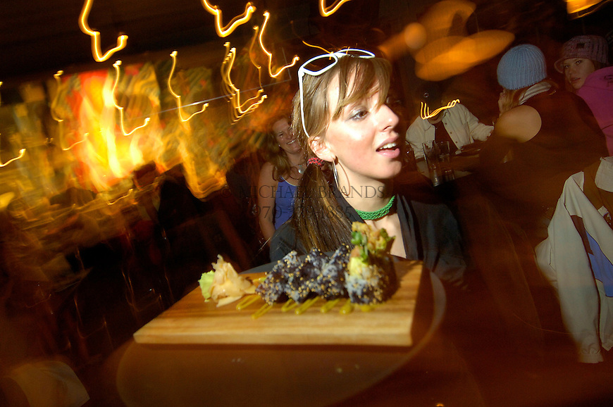 Waitress Erin Laine delivers sushi at the ultra-hip LoBar in Crested Butte, CO.  © Michael Brands.