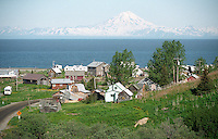 Mount Redoubt is the prominent landmark across Cook Inlet from the village of Ninilchik.